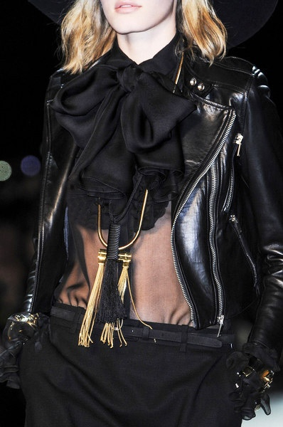 Saint Laurent Fall Winter 2013 line incorporates the mix of biker chic with retro, styles.