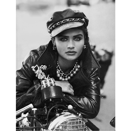 "Supermodel Helena Christensen channeled ""The Wild One"" in her leather jacket and Harley-Davidson leather biker cap. Image by © Peter Lindbergh"