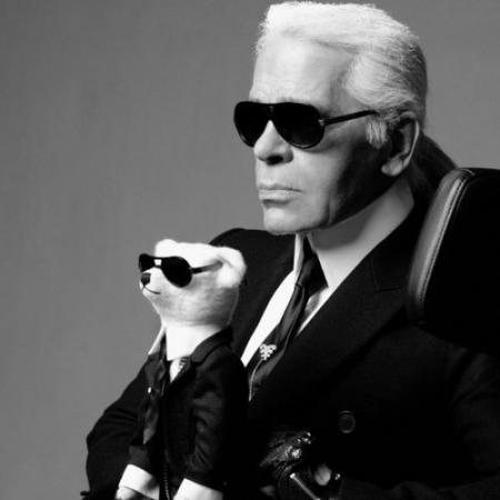 Karl Lagerfeld, a fashion icon and designer for Chanel, who always wears fingerless biker gloves as a statement, tends to add a biker twist to an iconic Chanel style for a modern, youthful look. Source: September '11 French Vogue