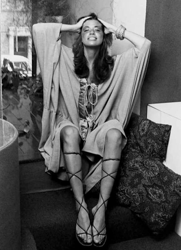 Carly Simon in knee-high gladiators, circa 1971, by Jack Robinson